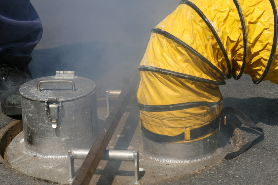 Smoke is circulated into sewer pipes using a type of candle and a fan.