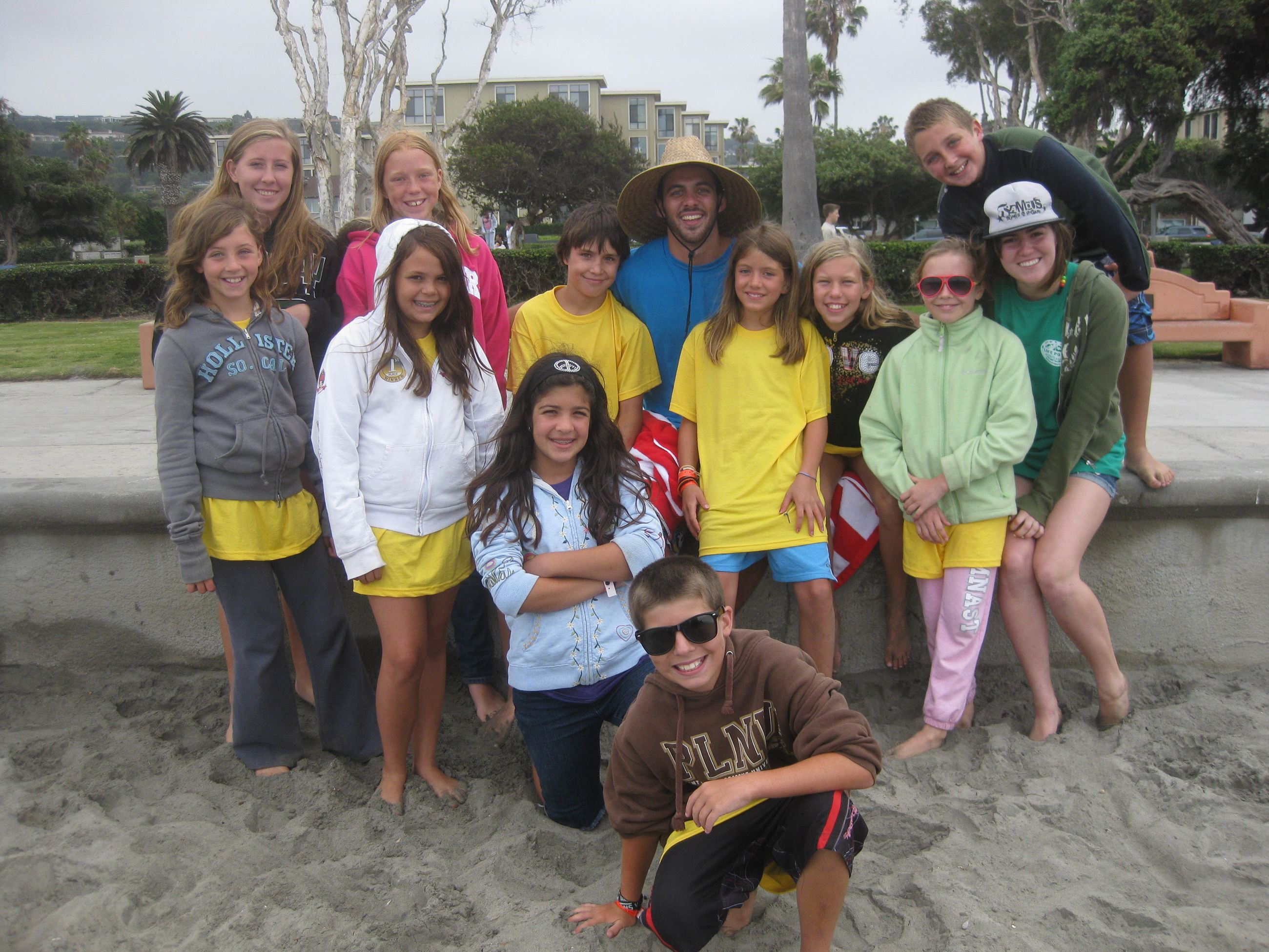 Group of Teens and Chaperones Stand in Sand